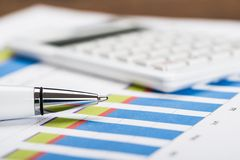 Financial Data Sheet With Calculator And Pen Stock Photography