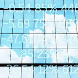 Financial data on  skyscraper windows Royalty Free Stock Images
