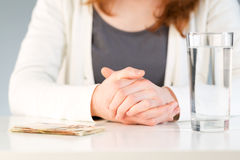 Financial decision - money and water Stock Images