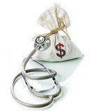 Financial Diagnostic. Stethoscope with money bag, The concept of financial diagnosis Royalty Free Stock Images