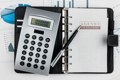 Financial diary and pen lying in the diagram Stock Photo