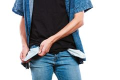 Male showing empty pockets. Financial difficulties, bad economy, no money concept. Young man student boy showing empty pockets, part of body male hips wearing Stock Photos
