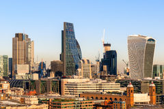 Financial District Cityscape of London. Against a blue cloudless sky Stock Photos