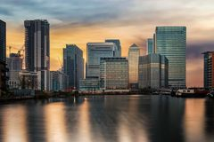 The financial district of London, Canary Wharf, United Kingdom. The financial district of London, Canary Wharf, with the diverse skyline, during sunset time royalty free stock images