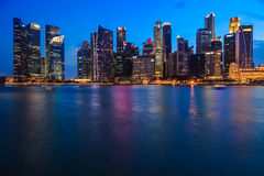 Financial district at Marina Bay, Singapore , twilight. SINGAPORE CITY, SINGAPORE - AUGUST 16, 2015: Cityscape of financial district during twilight on August 16 Stock Photo
