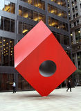 Financial District of New York City. Red Cube by Isamu Noguchi New York, USA May 20th, 2013 stock photo