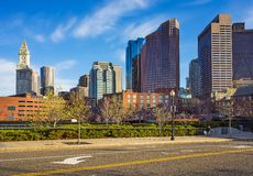 Financial District at North End Park at Boston USA. Boston, USA - April 29, 2015: Financial District and Custom House Tower at North End Park at Cross Street at stock photography