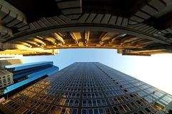 Financial District in NY. Fisheye lens looking up at some buildings in New York city in the financial district Royalty Free Stock Photos