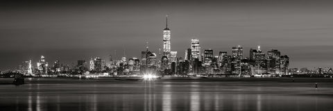 Financial District skyscrapers in Black & White at dawn from New York City Harbor Royalty Free Stock Images