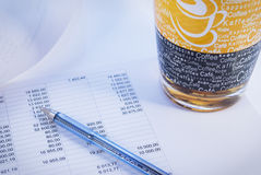 Financial document. Pen and mug stock images