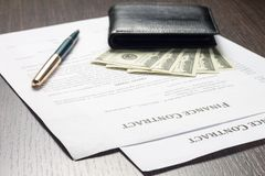 Financial document with money and fountain pen Royalty Free Stock Photos