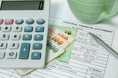Financial document, pen and calculator Royalty Free Stock Photos