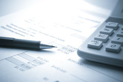 Financial Document with Pencil and Calculator Royalty Free Stock Photos