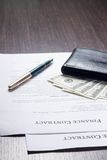 Financial document with wallet and fountain pen Stock Images