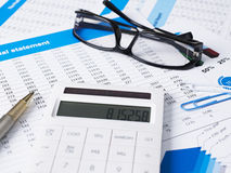 Financial documents. Calculator,glasses and pen on financial documents Stock Image