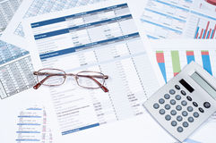 Financial documents. Glasses and calculator over financial documents Royalty Free Stock Photos
