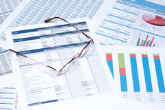 Financial documents. Glasses over financial documents and papers Royalty Free Stock Images