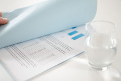Financial documents. A looking at financial documents Stock Photos