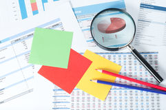 Financial documents. With magnifying glass over them Royalty Free Stock Photo