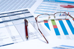 Financial documents. Pen and glasses over financial documents Royalty Free Stock Image