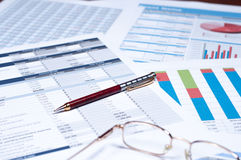 Financial documents. Pen and glasses over financial documents Royalty Free Stock Images