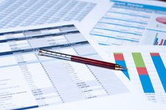 Financial documents. Pend over financial documents and papers Royalty Free Stock Photo