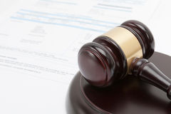 Financial documents with wooden gavel over it Royalty Free Stock Images