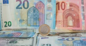 Financial dominance: One Euro in a vice against the background of the American Dollar and Euro with space for text stock photo