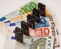 Financial domino Royalty Free Stock Image