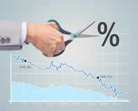 Financial and economical crisis concept. Business, people, default, financial and economical crisis concept - close up of businessman hand with scissors cutting Stock Photography
