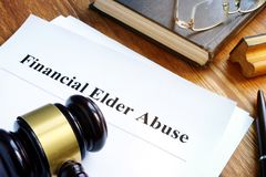 Financial Elder Abuse report and gavel. Financial Elder Abuse report and gavel in a court royalty free stock images