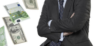 Financial executive with euro and dollar bills Stock Photography