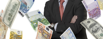 Financial executive with euro and dollar bills Stock Image