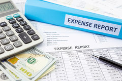 Financial expense report with money Royalty Free Stock Photos