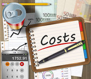 Financial expenses concept. Financial expenses as a concept on an office desk Royalty Free Stock Photography