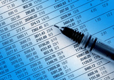 Financial figures. Close up of financial figures overlaid with blue Stock Images