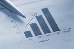 Financial figures. Making decision. Duotone bluetone Stock Image