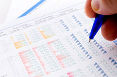Financial figures and pen Stock Photo