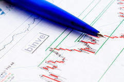 Financial figures and pen Stock Images