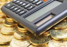 Financial forecast. Calculator and coins closeup Royalty Free Stock Photos