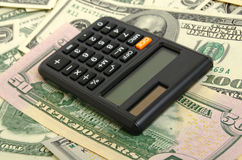 Financial forecast. Still Life with a calculator and dollars in cash in various denominations Stock Photo