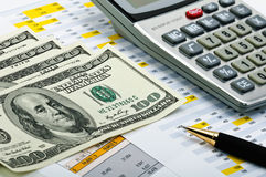 Financial forms with pen, calculator and money. Royalty Free Stock Photography