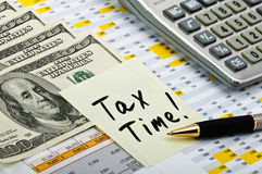 Financial forms with sticker Tax Time! Stock Image