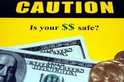 Financial fraud. Caution sign warning of financial fraud, white collar crime and keeping your money safe Stock Photo