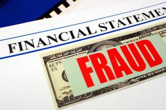 Financial Fraud. Financial statement and $100 dollar bill with red fraud on top of other paperwork Stock Photography