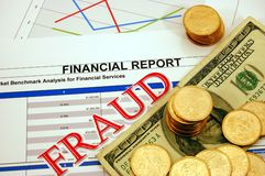 Financial Fraud. Fraud stamp on financial records with coins and bills Royalty Free Stock Images