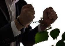 Financial fraud concept. Businessman, politician or man. Financial fraud concept. Businessman, politician or man in a suit in handcuffs. Business criminal in stock images
