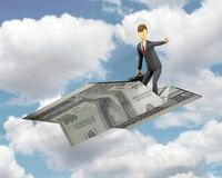 Financial freedom. Businessman doing a concept of financial freedom with taking a flight with money paper plane Stock Photo
