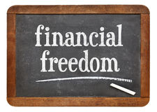 Financial freedom blackboard sign Stock Images