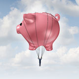Financial Freedom. Concept as a piggy bank hot air balloon lifting a businessman up to success as a wealth management and investment advice metaphor Royalty Free Stock Photos